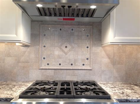 porcelain backsplash w custom mosaic stove accent inlay