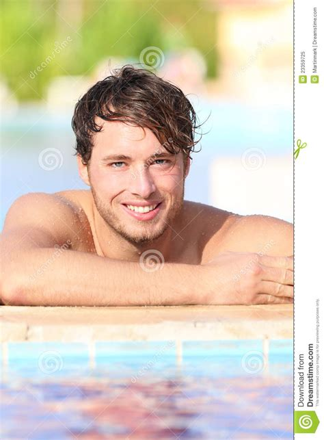 young model swimming man in swimming pool royalty free stock photo image