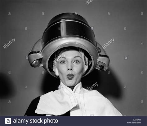 Hair Dryer Or Towel 1950s hair dryer with towel on shoulders and