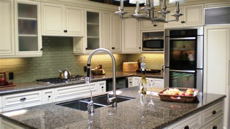 white kitchen cabinets with antique brown granite kitchen kreations services