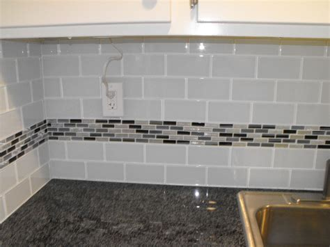 White Glass Subway Tile Kitchen Backsplash 22 Light Grey Subway White Grout With Decorative Line Of Mosaic Tiles Running Through