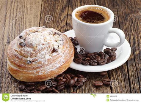 Cup Of Coffee And Bun Stock Photography   Image: 34635232