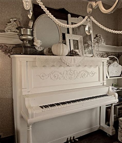 love this white piano and the whole display