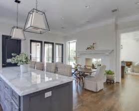 Transitional open concept kitchen photo in houston with recessed panel