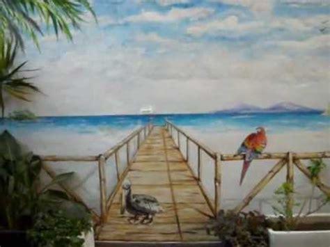 mural pintado la playa en una terraza videomusical