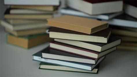 pile of books on blue background with alpha and z depth included stock footage 3841514
