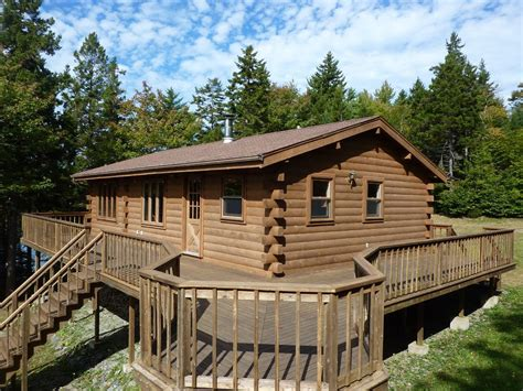 cedar log cabin with lakeshore on the