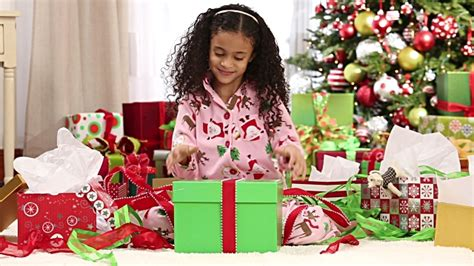 young girl opening christmas present stock footage video