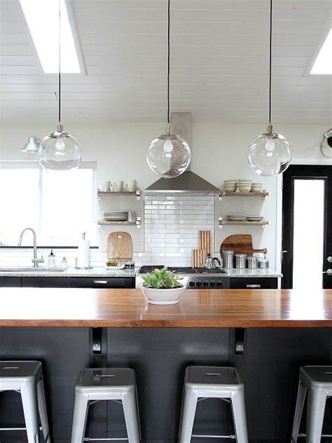 clear glass pendant lights for kitchen island an easy trick for keeping light fixtures sparkling clean glass pendants popsugar and pendant