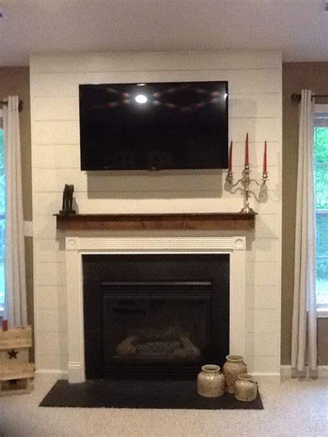 Shiplap fireplace surround with cedar mantle   Homemade