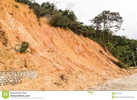 slope erosion with earth collapse at slope in tropical environme stock photo image 68110766