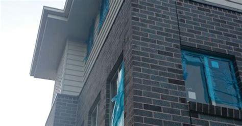 blue steel flash blue steel flash bricks and surfmist cladding hilltop house bricks exterior and