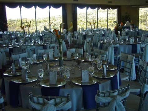 Silver linen, chargers, chairs White chair ties Blue