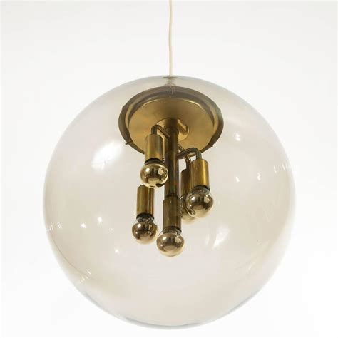 Large Glass Globe Pendant Light Large Limburg Pendant Light Brass And Glass Globe 1960s At 1stdibs