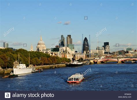 A City Sightseeing tourist cruise boat with City of London ...
