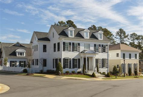 white home dream home house steps suburbs shutters front upscale white family home on street corner stock photo