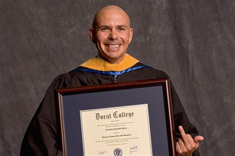Gets Honorary Mba Degree by This Photo Of Pitbull Holding An Honorary Degree From A