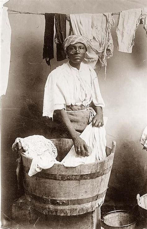 washing clothes in the bathtub black woman washing clothes by hand in an old wooden tub