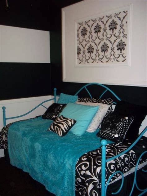 preteen girls room black white with a splash of blue small bedroom with large window and