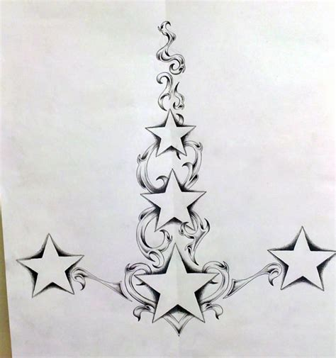 stars with swirls tattoo designs swirl spine design