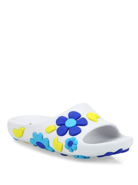 flower of rubber st prada flower rubber slides in blue lyst