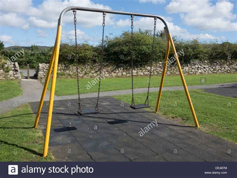 swing area children s swings in a play area stock photo royalty free