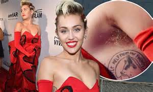 miley cyrus shows off armpit hair as she attends new york