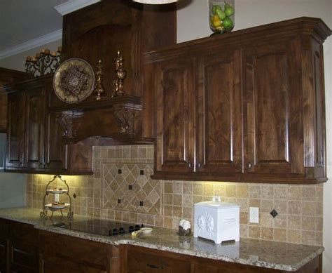our kitchen cabinets knotty alder in walnut stain not exact style but color and wood type is