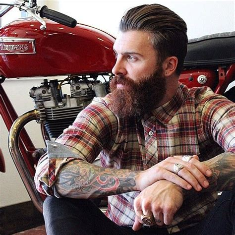long hairstyles for a biker man levi stocke full thick dark red beard and mustache