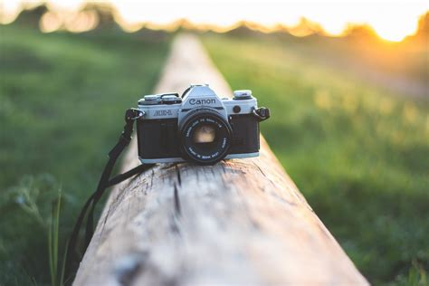 camera eye wallpaper a camera canon lens the camera sunset hd wallpaper