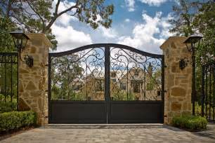 american house style with wrought iron entrance gate and unique wall lighting antiquesl com