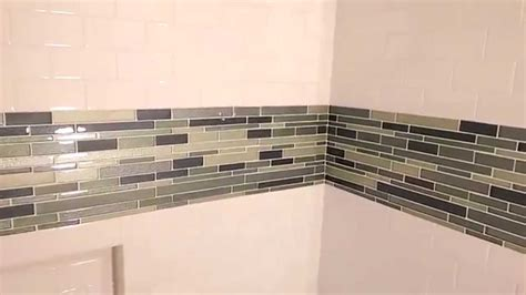 where can i find the tiles around the mirror they are how to tile around a tub youtube