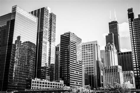 downtown chicago buildings in black and white photograph by paul velgos