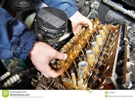 car engine service machanic repairman at automobile car engine repair stock