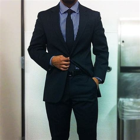 blue suit patterned shirt navy suit blue gingham shirt navy tie in the navy suit