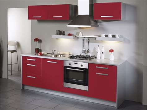 Red Kitchen With White Cabinets by Cuisine Rouge