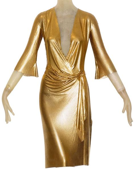 gold draped dress gianni versace s gold draped oroton dress to go gold