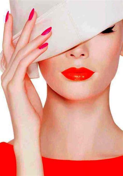 Beautiful Orange and Red Lipstick with Purple Nail Polish
