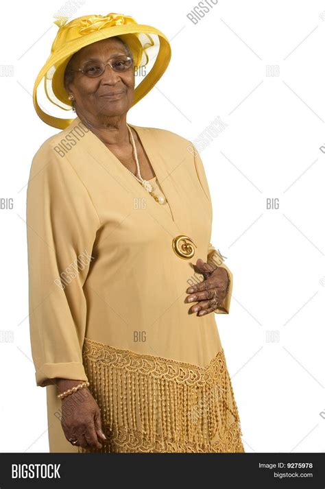 big older women african american old african american woman wearing yellow hat stock photo