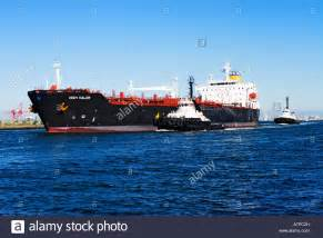 boat supplies port melbourne shipping industry petroleum tanker and a tugboats in