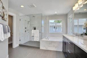 Contemporary master bathroom with undermount sink limestone counters