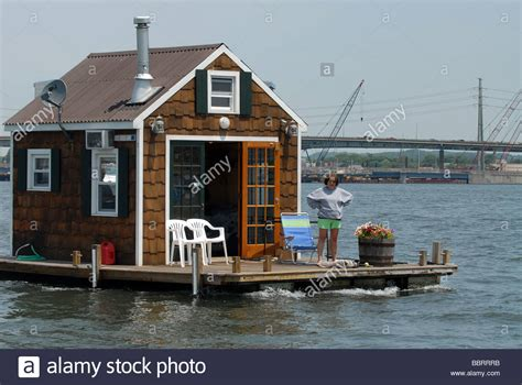 a houseboat motors through new haven harbor in long island - House Boats Long Island