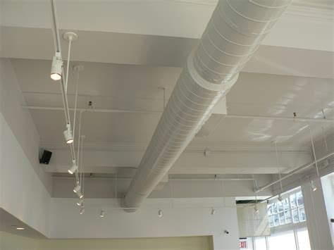 interior exterior white track lighting residential track maybe we paint out the duct work as well and go with the