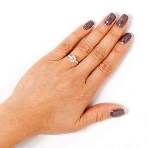 engagement ring on a finger finding the right size