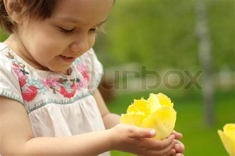 a beautiful baby in flowers stock photo colourbox