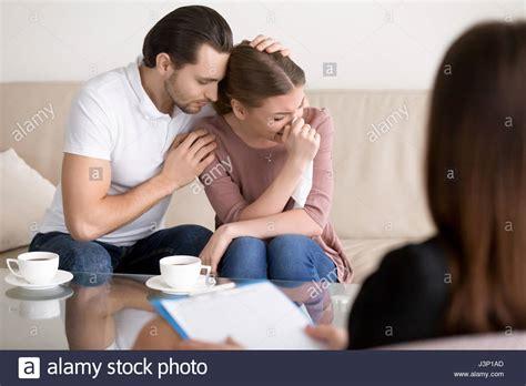 comforting crying girlfriend family couple counseling husband comforting sad crying