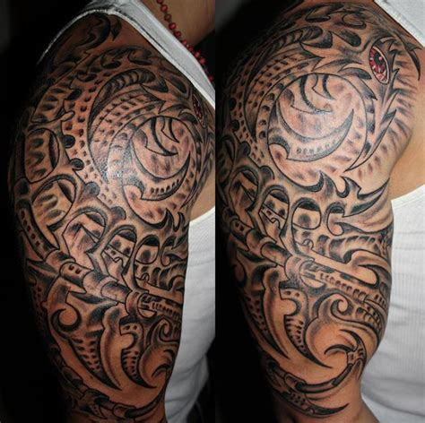 biomechanical tribal tattoo amazing tribal biomechanical on arm tattooshunt