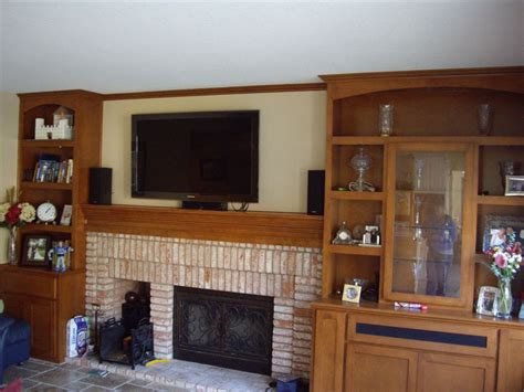 Kitchen Corner Cabinet Ideas custom built in shelves with mantel and tv over fireplace