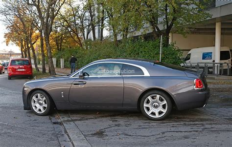 roll royce sport car rolls royce wraith sport spied wearing massive spoilers