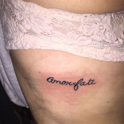 amor fati tattoo side saying quot fati quot on